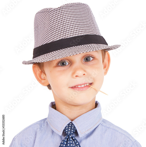 Portrait of cool pretty stylish little boy with toothpick