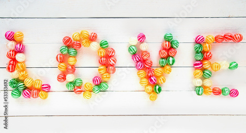 Poster The Love word written with sweet candies
