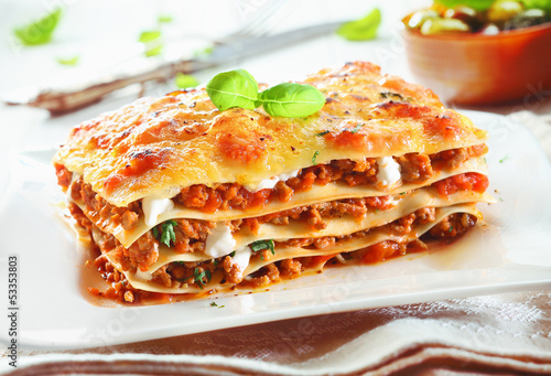 Papiers peints Table preparee Traditional lasagna with bolognese sauce