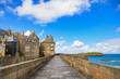 Saint Malo city walls, houses and beach. Brittany, France.