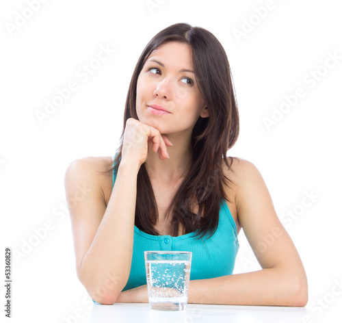 Woman getting ready to drink glass of water