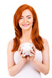 Smiling woman with her piggy bank