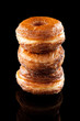 Croissant and doughnut mixture pile isolated on black