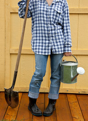 Woman holds gardening tools