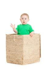 little boy  inside a box on a white background
