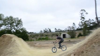 BMX biker jumping dirt jumps