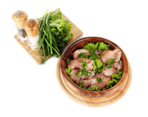 Chicken meat in wooden bowl, herbs, spices isolated on white