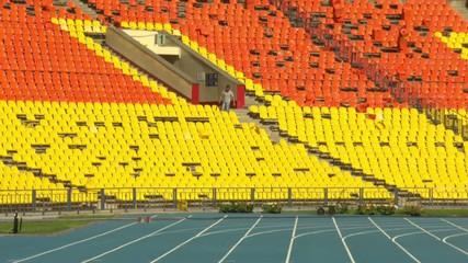 man breaks seats in the stadium man breaks seats in the stadium