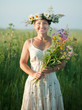 mature  woman in camomile wreath