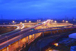 modern city with highway overpass in sunset night scene