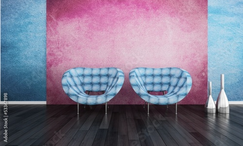 Two blue chairs against pink wall