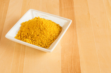 Dish of tumeric spice for use in cooking