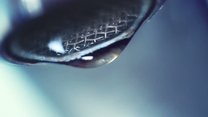 dropping faucet close-up slowmotion