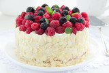 Sponge cake with cream and raspberries.