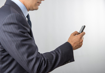 the man holds a mobile