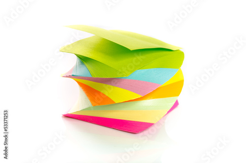 Pile of colorful post-it notes stacked on spiral