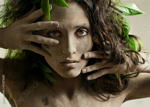young woman, smeared with clay