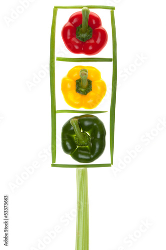 Traffic lights with colored peppers, chives and celery