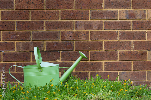 A watering can outside in a garden