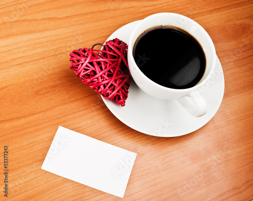 Red straw heart and cup of coffee