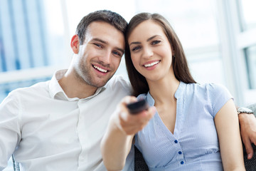 Young couple with TV remote