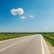 asphalt road to horizon under blue sky