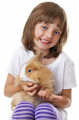 little girl with a baby rabbit - white background