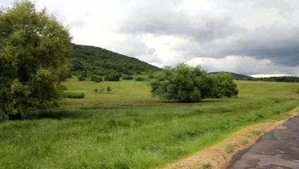 Landscape with old road and clouds