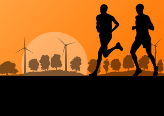 Men marathon runners in wild countryside forest nature landscape