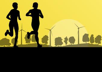 Women marathon runners in wild countryside forest nature landsca
