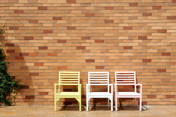 chair and red brick wall