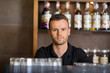 Confident Male Bartender At Cafe