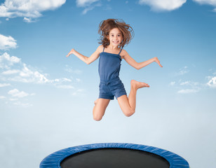cheerful young girl jumping