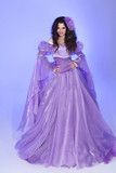 Beautiful woman model posing in Long Chiffon dress over purple i