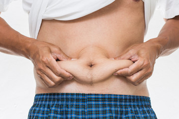 Man showing his fat on the stomach