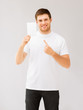 man pointing at blank white paper