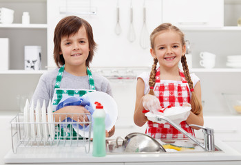 Happy kids helping in the kitchen