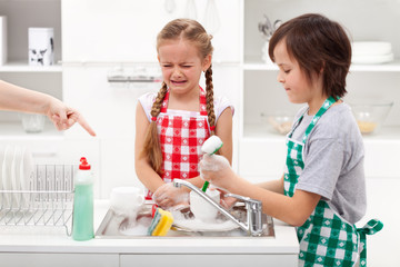 Do the dishes - kids ordered to help in the kitchen