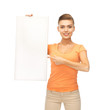 woman pointing at white blank board