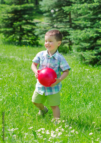 Little boy playing with ball in the park