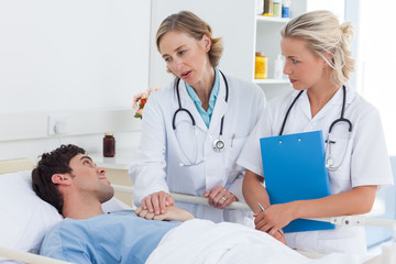 Doctors talking to a patient