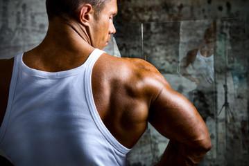 A beautiful young muscular man's shoulder