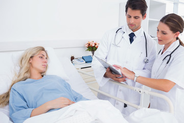 Hospitalized woman and doctors
