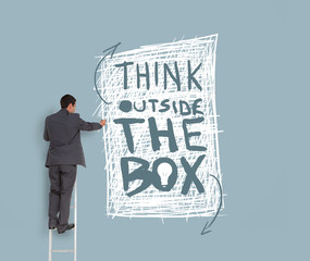 Businessman drawing think outside the box message