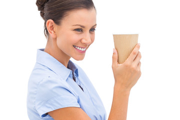 Cheerful businesswoman holding a coffee cup