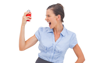 Businesswoman screaming at alarm clock