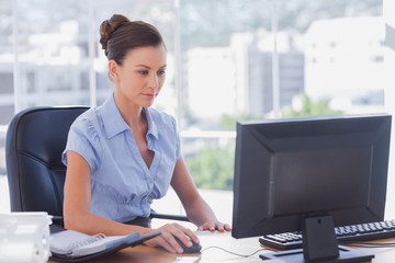 Businesswoman working on her computer