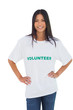 Cheerful woman wearing volunteer tshirt