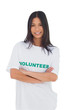 Woman wearing volunteer tshirt with arms crossed