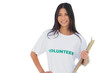 Attractive woman wearing volunteer tshirt holding clipboard